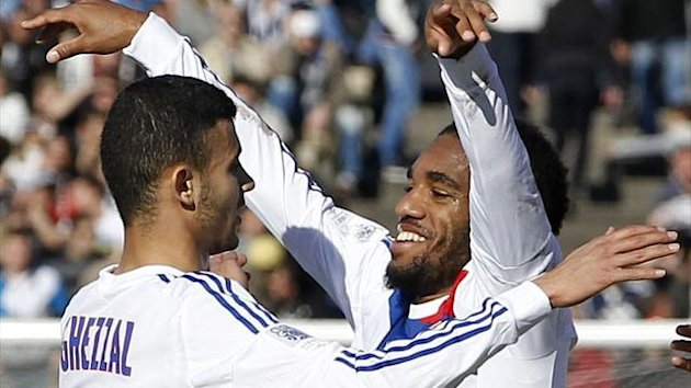 Olympique Lyon's Alexandre Lacazette (R) celebrates with his teammate Rachid Ghezzal (Reuters)