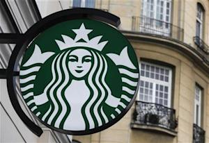 The Starbucks logo is seen outside the new Starbucks cafe in Warsaw