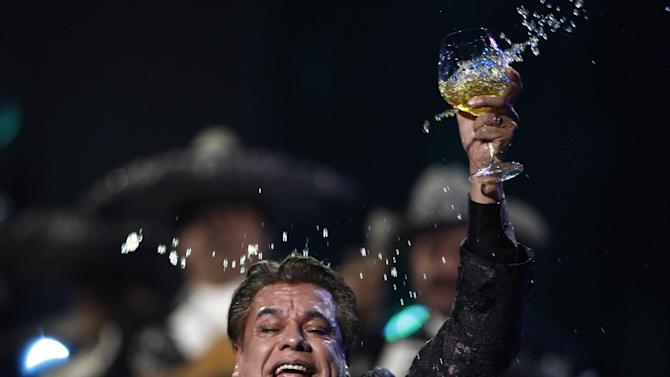 FILE - In this Thursday, Nov. 5, 2009, file photo, Juan Gabriel performs at the 10th Annual Latin Grammy Awards in Las Vegas. Juan Gabriel has postponed three California shows after being hospitalized in Las Vegas with pneumonia. A publicist for the singer said Tuesday, April 15, 2014 that the 64-year-old singer was taken to intensive care Monday, the morning after performing a three-hour concert at the Mandalay Bay resort. (AP Photo/Matt Sayles, File)