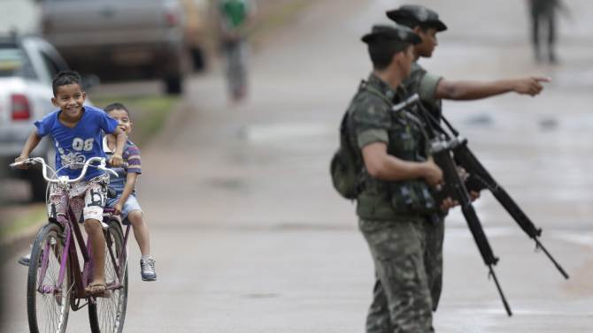 "Brazilian Army soldiers patrol a street as part of the operation named ""Agata"" in the town of Oiapoque"