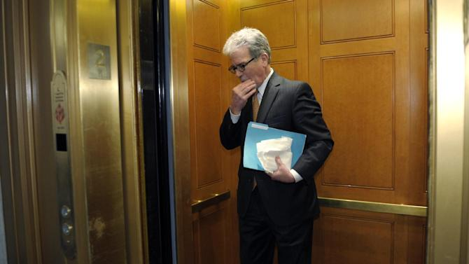 FILE - In this Dec. 31, 2012 file photo, Sen. Tom Coburn, R-Okla. gets into an elevator on Capitol Hill in Washington.  Gun control senators are discussing revising the defeated background check bill in attempt to revive it. (AP Photo/Susan Walsh)