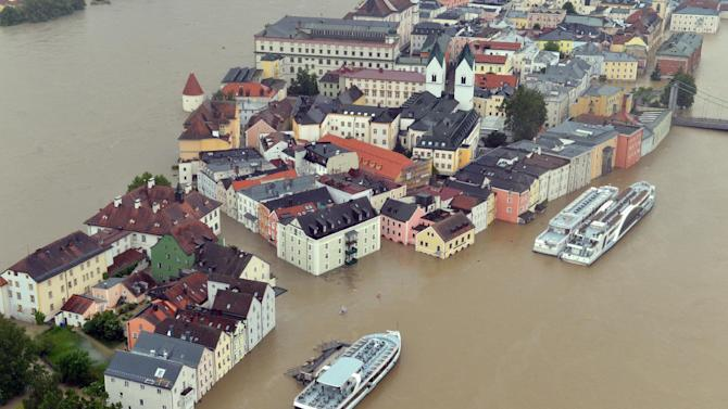 An aerial view of the flooding in Passau, Germany, photographed  Monday June 3,  2013. Heavy rainfalls cause flooding along rivers and lakes in Germany, Austria, Switzerland and the Czech Republic.   (AP Photo/dpa,Peter Kneffel)