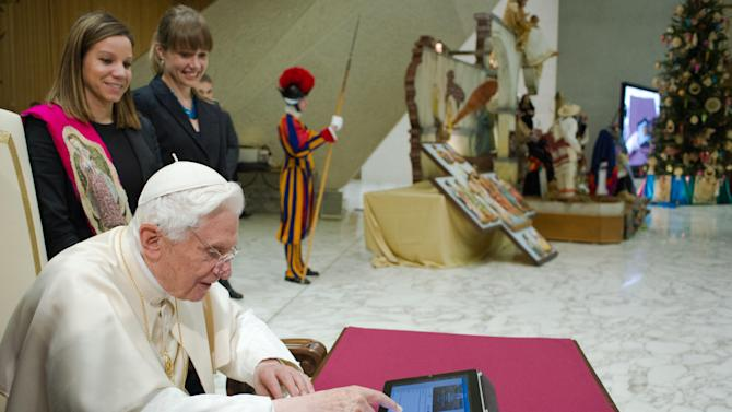 FILE - In this Dec. 12, 2012 file photo provided by the Vatican newspaper L'Osservatore Romano, Pope Benedict XVI pushes a button on a tablet at the Vatican as he sent his first tweet from his new account, blessing his online fans and urging them to listen to Christ. Vatican intern and Villanova student Andrew Jadick helped the church prepare for a tweeting pope by researching how other major world figures use their Twitter accounts. Jadick was among those who stood by the pope on Dec. 12 when he tweeted for the first time, and got to shake the pontiff's hand. (AP Photo/Osservatore Romano, File)