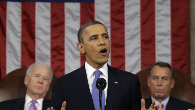 President Barack Obama, flanked by Vice President Joe Biden and House Speaker John Boehner of Ohio, gives his State of the Union address during a joint session of Congress on Capitol Hill in Washington, Tuesday Feb. 12, 2013. (AP Photo/Charles Dharapak, Pool)