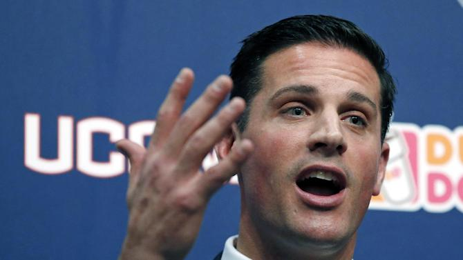 In this Dec. 12, 2013 file photo, Bob Diaco, former Notre Dame defensive coordinator, speaks after being introduced as Connecticut's new head football coach on campus in Storrs, Conn. Diaco acknowledges he's detail oriented. Two months into the job, there have been some changes at UConn's Shenkman football training center, all ordered by Diaco, who spent some time with a pad and pen diagramming every room in the building. UConn's spring practice begins on March 10