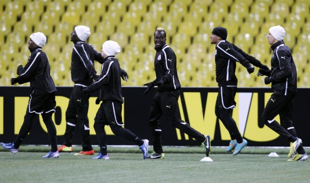 Newcastle players run during a training session at the Luzhniki stadium in Moscow