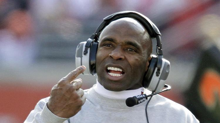 Louisville coach Charlie Strong directs his team against Connecticut during an NCAA college football game in Louisville, Ky., Saturday, Nov. 24, 2012. UConn 23-20 in triple overtime.  (AP Photo/Garry Jones)
