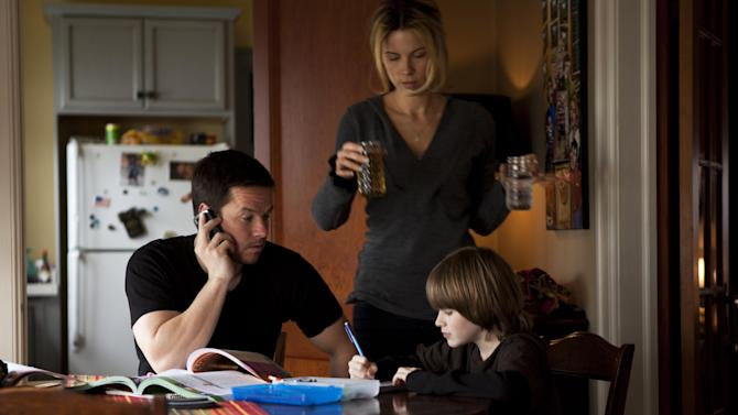 "FILE - In this publicity film image released by Universal Pictures, Mark Wahlberg, left, Kate Beckinsale and Connor Hill are shown in a scene from ""Contraband."" The cable network, HBO, postponed airings of the 2012 crime thriller ""Contraband"" over the weekend. The film with Mark Wahlberg and Kate Beckinsale was replaced by airings of ""Crazy, Stupid Love"" and the remake of ""Arthur,"" the network said. (AP Photo/Universal Pictures, Patti Perret, File)"