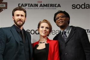 "File photo of cast members Evans, Johansson and Jackson pose at the French premiere of the film ""Captain America: The Winter Soldier"" in Paris"