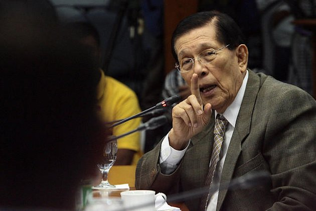 Senate President Juan Ponce Enrile questions a resource person during the continuation of the Senate hearing investigating the alleged illegal shipment of 420,000 sacks of Indian rice in Subic Bay Freeport Zone at the Senate in Pasay City, south of Manila, on 17 December 2012. (Voltaire Domingo/NPPA Images)
