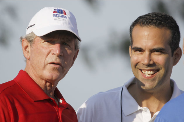 FILE - In this Monday, Sept. 24, 2012, file photo George P. Bush, right, stands with his uncle former President George W. Bush, left, during the Bush Center Warrior Open in Irving, Texas. George P. Bu
