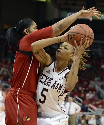 No. 9 Louisville women edge No. 15 Texas A&M 47-45
