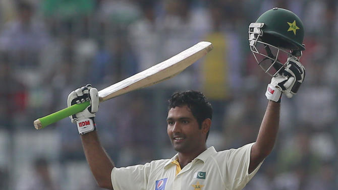 Pakistan's Asad Shafiq acknowledges the crowd after scoring a century during the second day of the second test cricket match against Bangladesh in Dhaka, Bangladesh, Thursday, May 7, 2015. (AP Photo/ A.M. Ahad)