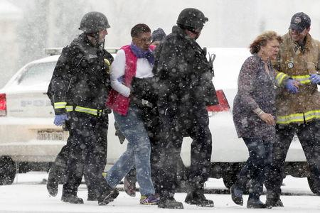 Two women are evacuated from a building where a shooter was suspected to be still holed up in Colorado Springs, Colorado