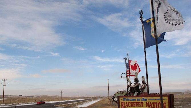 This Dec. 12,2012 photo shows a sign welcoming visitors to the Blackfeet Indian reservation on Dec. 12, 2012. Glacier officials are concerned about the effects of oil development on the reservation, and are asking for an in-depth study on the environmental impacts. Blackfeet tribal officials say they are complying with all requirements before drilling and they bristle at the suggestion they can't develop their resources safely. (AP Photo/Matt Volz).