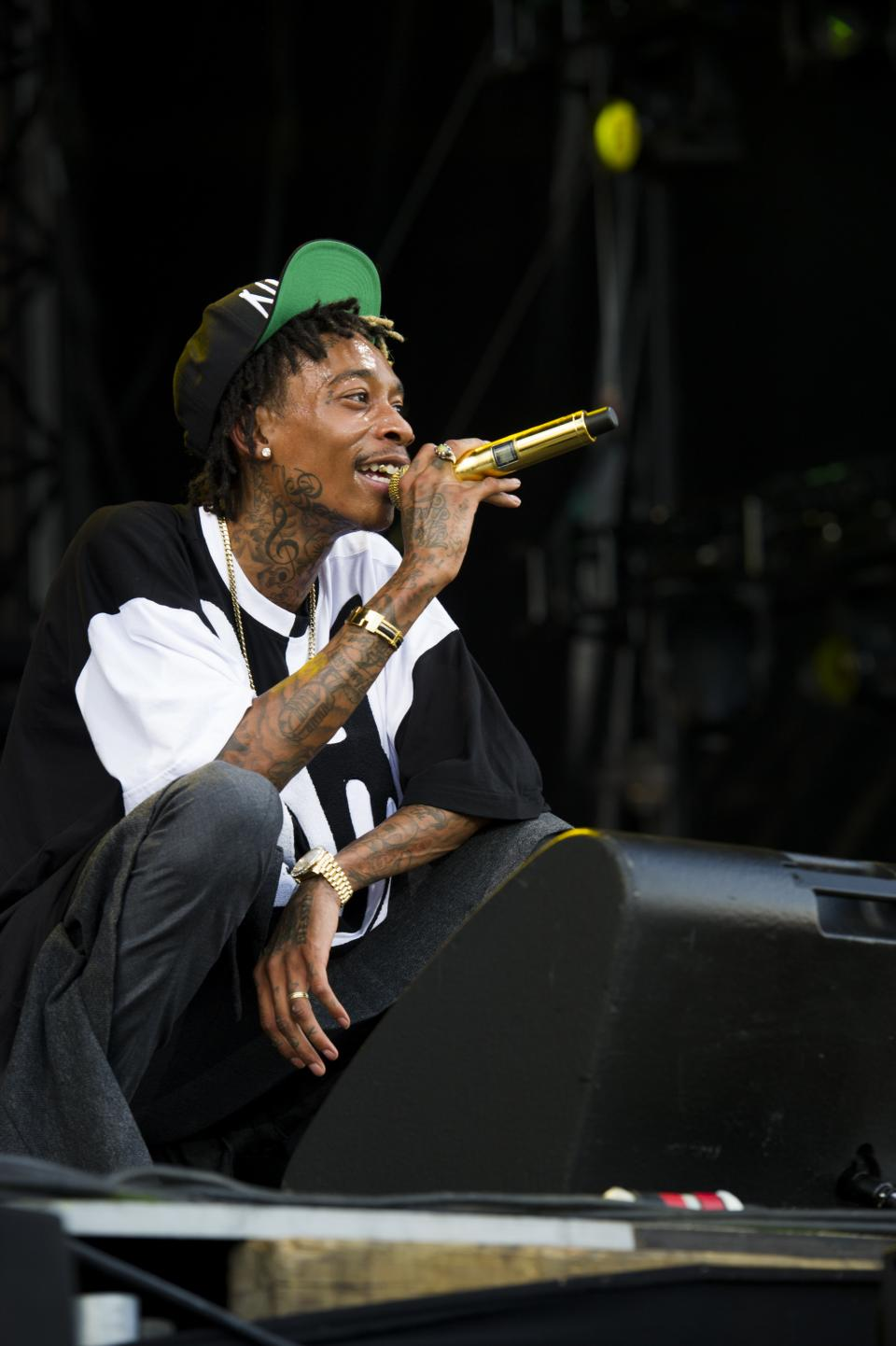 Wiz Khalifa performs on day two of the 2013 Budweiser Made in America festival on Sunday, Sept. 1, 2013 in Philadelphia. (Photo by Charles Sykes/Invision/AP)