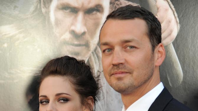 "FILE - This May 29, 2012 file photo shows actress Kristen Stewart and director Rupert Sanders attending the ""Snow White and the Huntsman"" screening in Los Angeles. Stewart and director Rupert Sanders apologized publicly to their loved ones following reports of infidelity. The 22-year-old actress and the 41-year-old filmmaker issued separate apologies to People magazine Wednesday, July 25, saying they regret the hurt they have caused. Stewart has been in a relationship for several years with her ""Twilight"" co-star Robert Pattinson. Sanders is married and has two children. (Photo by Jordan Strauss/Invision/AP)"