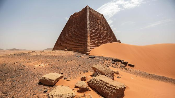 In this Thursday, April 16, 2015 photo, a view of the historic Meroe pyramids in al-Bagrawiya, 200 kilometers (125 miles) north of Khartoum, Sudan. The steep, small pyramids rise over the desert hills, a stunning reminder of the ancient Nubian kingdom that once ruled Egypt _ and ones not nearly as visited as those of its neighbor. (AP Photo/Mosa'ab Elshamy)