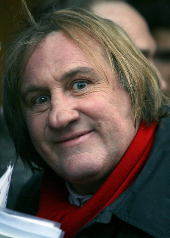 FILE- This April 14, 2010 file photo shows French actor Gerard Depardieu posing for a photograph as his arrives for the inauguration of U.S. fashion designer Ralph Lauren&#39;s new shop in Paris. Gerard Depardieu, the French actor who has been sparring with his native country over taxes, has been granted Russian citizenship. A brief announcement on the Kremlin website said President Vladimir Putin signed the citizenship grant on Thursday Jan. 3, 2013. (AP Photo/Jacques Brinon, File)