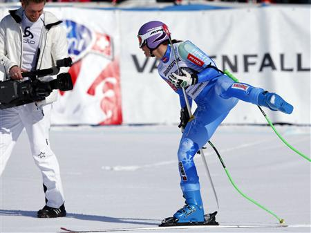 Slovenia's Tina Maze celebrates in front of a cameraman after the women's Alpine Skiing World Cup Downhill race in Garmisch-Partenkirchen March 2, 2013. REUTERS/Michael Dalder