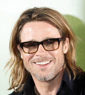 """Actor Brad Pitt smiles during a press conference of his latest film, """"Moneyball,"""" in Seoul, South Korea, Tuesday, Nov. 15, 2011. (AP Photo/Lee Jin-man)"""