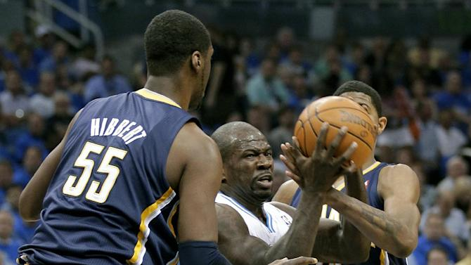 Indiana Pacers' Roy Hibbert (55) and Paul George, right, put pressure on Orlando Magic's Jason Richardson, center, as he looks to pass the ball during the first half of Game 3 of an NBA first-round playoff basketball series, Wednesday, May 2, 2012, in Orlando, Fla. (AP Photo/John Raoux)