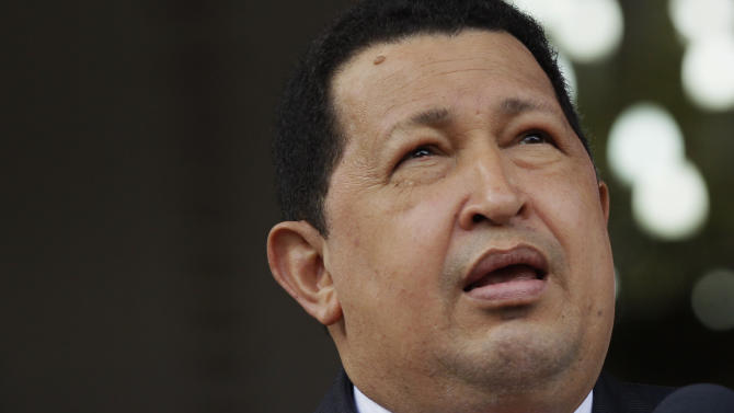 Venezuela's President Hugo Chavez looks up as he waits for the arriving of Belarus' President Alexander Lukashenko at Miraflores presidential palace in Caracas, Venezuela, Tuesday, June 26, 2012.  (AP Photo/Ariana Cubillos)