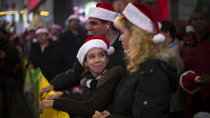 Shoppers wait in line for the 8 p.m. opening of the Times Square Toys-R-Us store, Thursday, Nov. 22, 2012, in New York. While stores typically open in the wee hours of the morning on the day after Thanksgiving known as Black Friday, openings have crept earlier and earlier over the past few years. Now, stores from Wal-Mart to Toys R Us are opening their doors on Thanksgiving evening, hoping Americans will be willing to shop soon after they finish their pumpkin pie. (AP Photo/John Minchillo)