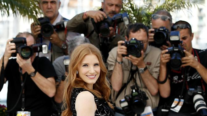Actress Jessica Chastain poses for photographers during a photo call for The Disappearance of Eleanor Rigby at the 67th international film festival, Cannes, southern France, Sunday, May 18, 2014. (AP Photo/Alastair Grant)