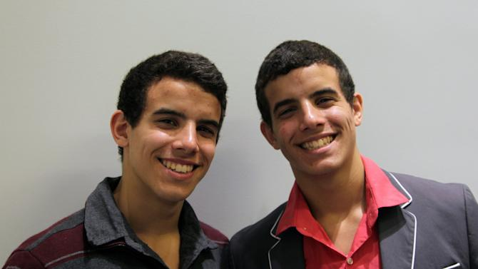 """This Sept. 26, 2012, photo shows Jacob, left, and David Guzman, 17-year-old identical twins and dancers from Brockton, Mass., posing after a matinee of Broadway's """"Newsies"""" at the Nederlander Theatre in New York. (AP Photo/Mark Kennedy)"""