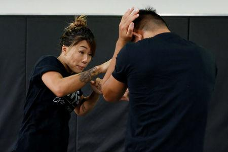 MMA fighter Angela Lee trains with her brother Christian Lee in Singapore