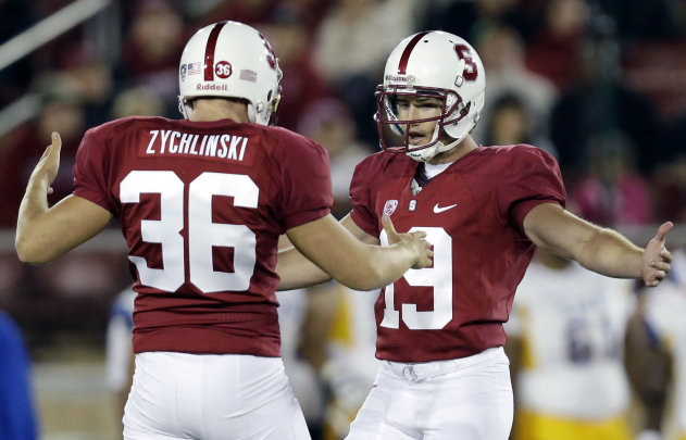 Stanford kicker Jordan Williamson (19) celebrates with teammate Daniel Zychlinski (36) after making a 46-yard field goal against San Jose State during the first half of an NCAA college football game in Stanford, Calif., Friday, Aug. 31, 2012. (AP Photo/Marcio Jose Sanchez)