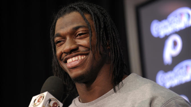 Washington Redskins quarterback Robert Griffin III smiles as he speaks during a news conference following NFL football practice at Redskins Park in Ashburn, Va., Wednesday, Jan. 2, 2013. The Redskins worked out before Sunday's wild card game against the Seattle Seahawks. (AP Photo/Susan Walsh)