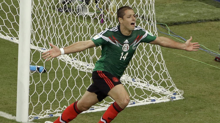 FILE - This is a Monday, June 23, 2014 file photo of Mexico's Javier Hernandez, as he celebrates scoring his side's 3rd goal during the group A World Cup soccer match between Croatia and Mexico at the Arena Pernambuco in Recife, Brazil. Real Madrid has signed Mexico striker Javier Hernandez on a season-long loan from Manchester United. Madrid announced the deal hours before the close of the summer transfer window on Monday Sept. 1, 2014. (AP Photo/Hassan Ammar)