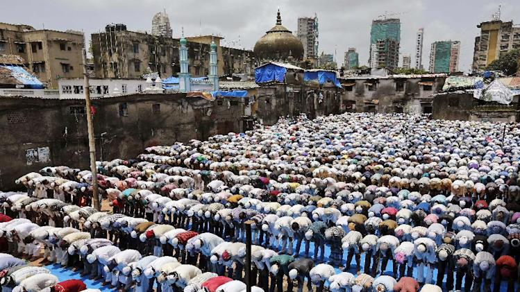 Indian Muslims pray inside a mosque on the last Friday of Ramadan in Mumbai, India, Friday, July 25, 2014. Muslims across the world are observing Ramadan, the Islamic holy month of fasting. (AP Photo/Rajanish Kakade)