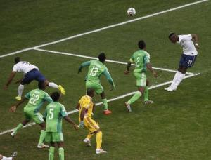 France's Pogba heads to score a goal against Nigeria during their 2014 World Cup round of 16 game in Brasilia
