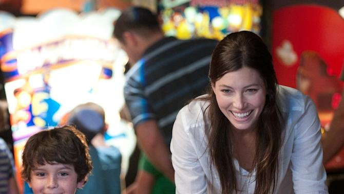 "This film image released by FilmDistrict shows Jessica Biel, right, and Noah Lomax in a scene from ""Playing for Keeps."" (AP Photo/FilmDistrict, Dale Robinette)"