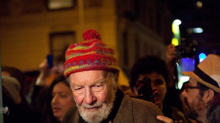 "Activist musician Pete Seeger, 92, exits the Symphony Space on the Upper West Side to march with nearly a thousand demonstrators sympathetic to the Occupy Wall Street protests for a brief acoustic concert in Columbus Circle, Friday, Oct. 21, 2011, in New York. The demonstrators marched down Broadway singing ""This Little Light of Mine"" and other folk and gospel songs while ad-libbing lines about corporate greed and social justice. (AP Photo/John Minchillo)"