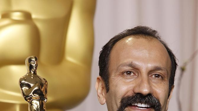 "FILE - In this Sunday, Feb. 26, 2012 file photo, Asghar Farhadi, of Iran, poses with the Oscar for best foreign language film for ""A Separation"" during the 84th Academy Awards in the Hollywood section of Los Angeles. Iranian authorities canceled a ceremony Monday in honor of the country's Oscar-winning director even though the government had hailed his win as a triumph over a competitor from Israel. The event for Asghar Farhadi, whose movie, ""A Separation,"" won the Oscar for best foreign film last month, was abruptly scrapped after authorities denied permission, according to the semiofficial Ilna news agency.(AP Photo/Joel Ryan, File)"
