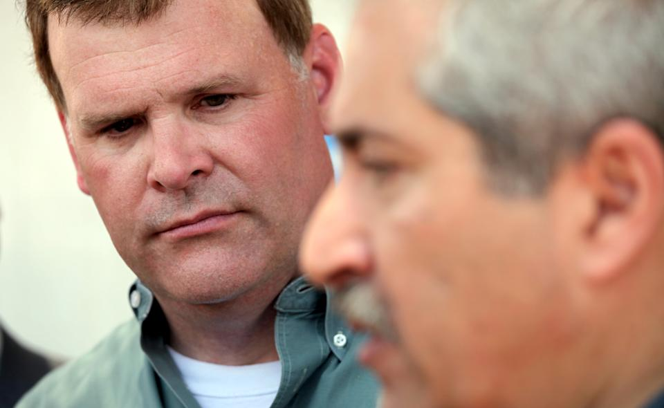 Canadian Foreign Affairs Minister John Baird, left, listens to his  Jordanian counterpart Nasser Judeh  during their tour of Zaatari camp for Syrian refugees in Mafraq, Jordan, Saturday, Aug. 11, 2012.  (AP photo/Mohammad Hannon)