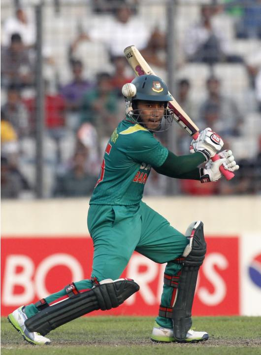 Bangladesh's captain Mushfiqur Rahim plays a shot against New Zealand during their first one-day international (ODI) cricket match in Dhaka