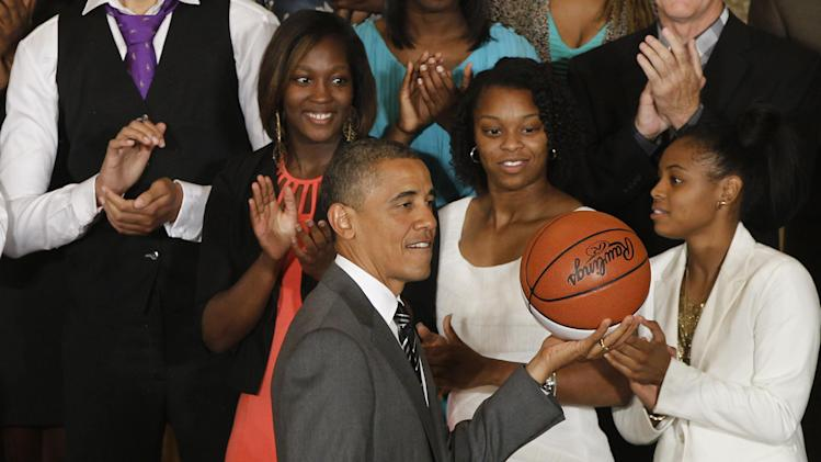 President Barack Obama holds a basketball at a ceremony honoring the 2012 NCAA Women's basketball champions Baylor University Bears in the East Room at the White House in Washington, Wednesday, July 18, 2012. (AP Photo/Charles Dharapak)
