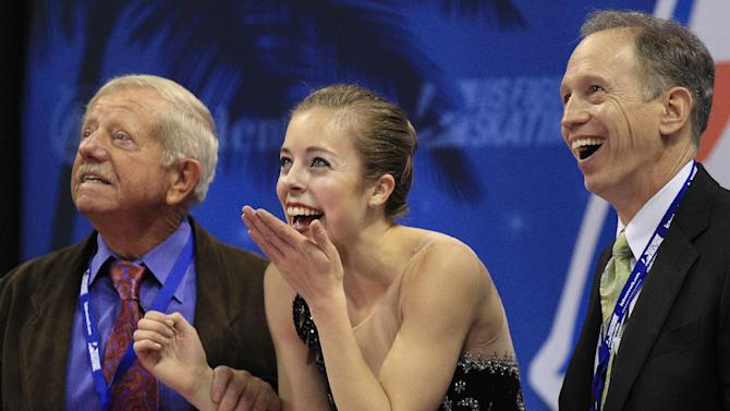Ashley Wagner, center, reacts after seeing her scores in the ladies free skate event at the U.S. Figure Skating Championships in San Jose, Calif., Saturday, Jan. 28, 2012. (AP Photo/Marcio Jose Sanchez)