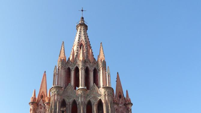 Palm trees frame the facade of the 19th-century neo-Gothic Parroquia church, an emblem of San Miguel de Allende
