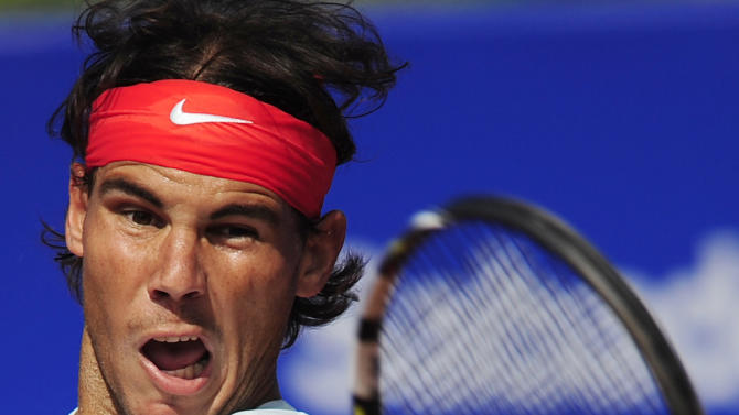 Rafael Nadal of Spain returns the ball to Benoit Paire of France during the Barcelona open tennis in Barcelona, Spain, Friday, April 26, 2013. Nadal won 7-6, 6-2. (AP Photo/Manu Fernandez)