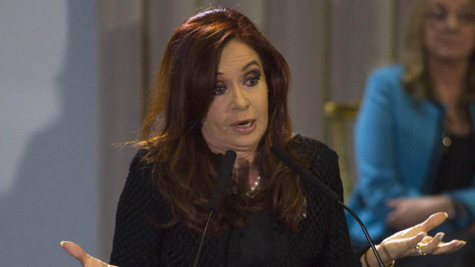 Argentina's President Cristina Fernandez gestures as she announces a new housing-credit program in Buenos Aires, Argentina, Tuesday, June 12, 2012. (AP Photo/Eduardo Di Baia)