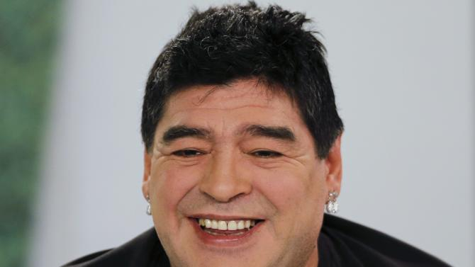 Argentina's soccer legend Diego Maradona smiles as he hosts his television show 'De Zurda' in Caracas