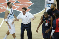 United States' coach Mike Krzyzewski, center, helps break off a scuffle between Argentina's Juan Gutierrez, left, and Kevin Durant of the United States (5) during a preliminary basketball match at the 2012 Summer Olympics, Tuesday, Aug. 7, 2012, in London. (AP Photo/Victor R. Caivano)