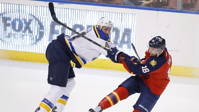 St. Louis Blues defenseman Robert Bortuzzo, left, shoves Florida Panthers right wing Reilly Smith (18) as they battle for position during the third period of an NHL hockey game, Friday, Feb. 12, 2016, in Sunrise, Fla. The Blues defeated the Panthers 5-3. (AP Photo/Wilfredo Lee)