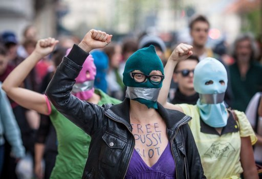 <p>Supporters of the Russian punk band 'Pussy Riot' are seen during a protest in front of the Russian embassy in Warsaw, on August 17. A Moscow court handed a two-year jail sentence to the three feminist punk rockers who infuriated the Kremlin and captured world attention by ridiculing President Vladimir Putin in Russia's main church.</p>